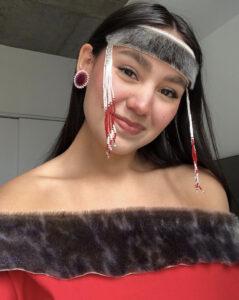 Shina Nova smiling wearing seal skin silapaaq.
