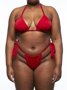 Model wearing red bikini top and bottoms.