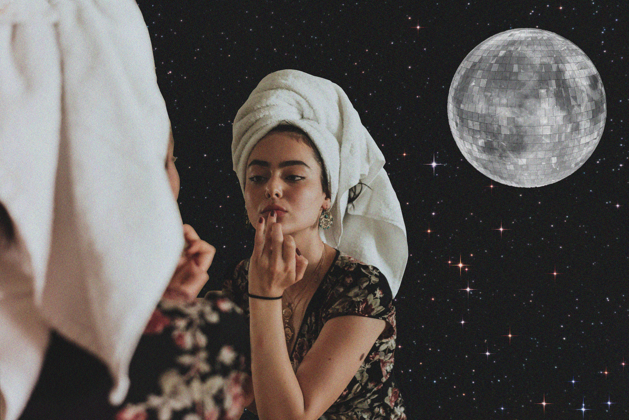 Woman staring in reflection with disco moon behind her