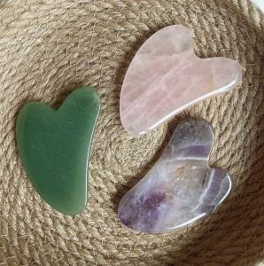 Jade, Rose Quartz and Amethyst Gua Sha Tools in a woven basket